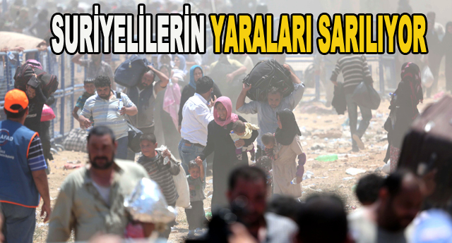 Suriyelilerin yaraları sarılıyor