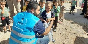 Suriyeli yetimlere kışlık yardımı